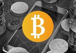 Icon mit Logo von Bitcoin. Handy und Bitcoins im Hintergrund
