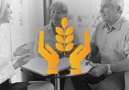 Icon mit Händen und im Hintergrund 2 ältere Personen, welche eine Lebensversicherung abschließen