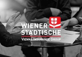 """Logo von """"Wiener Städtische"""" mit Leuten im Hintergrund"""